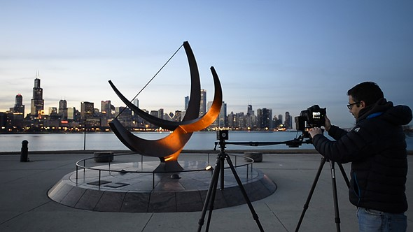 The Lynx system extended to 48 inches (122 cm) in length and supported by two Gitzo carbon fiber tripods. The leveling tripod on the left has an adjustable center column while the other one has a ball head. These make leveling or inclining the slider fairly easy. Location: Sundial Plaza, Adler Planetarium, Chicago Once set up, it's easy to program the motion controller. You simply slide t